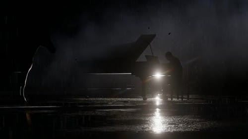 Man Playing the Piano While It Is Pouring Rain