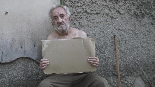 Thumbnail for Homeless Man with a Sign Asking for Help