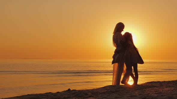 Thumbnail for Mom and Daughter Are Looking Forward To a Beautiful Sunset Over the Sea