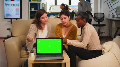 International Business Team Talking in Back of Mockup Laptop