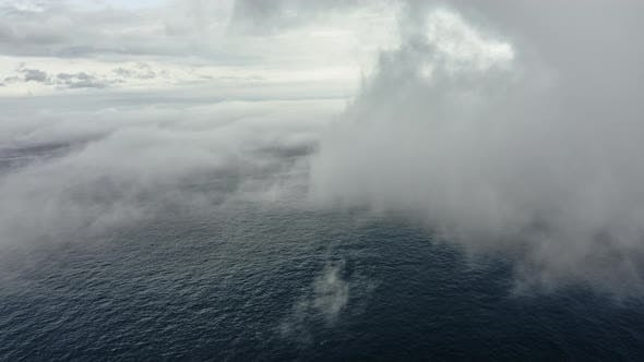 Thumbnail for Blue Ocean Waters Covered By Fog in Foreground and Clear Sky in the Background
