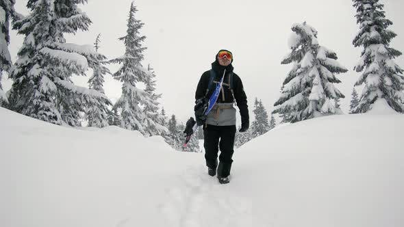 Thumbnail for Backcountry Snowboarder Hiking Trail Snow Falling