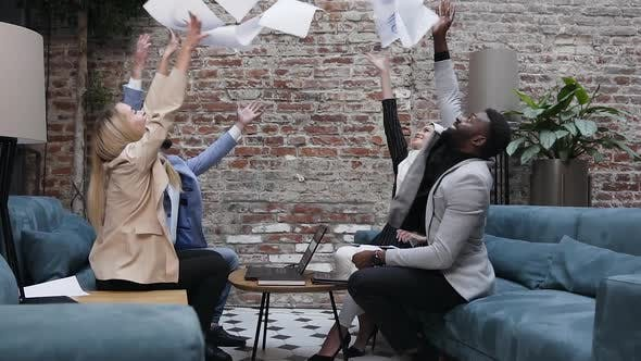 Cover Image for Business People Team Throwing Up Work Papers Celebrate Corporate Success and Victory