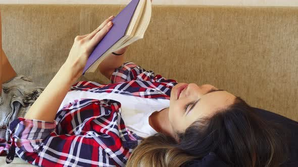 Thumbnail for The Girl Is Reading a Book