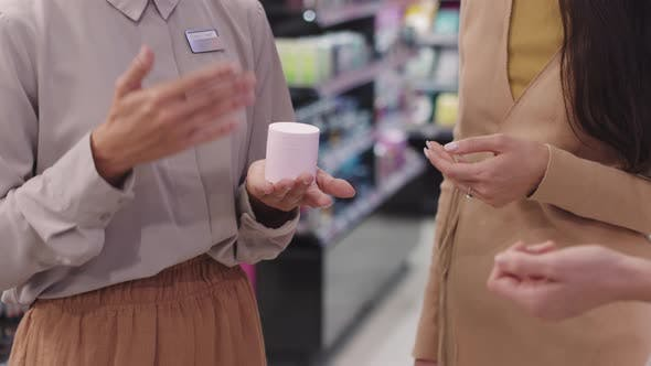 Beauty Advisor Speaking to Customers In Shop