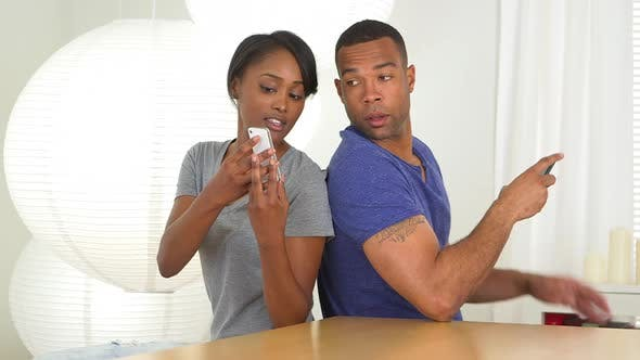 Thumbnail for Black girlfriend shows boyfriend photo on mobile phone