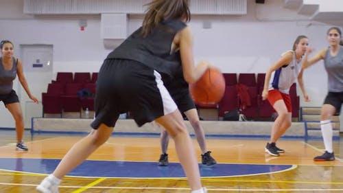 Schoolgirls Playing Basketball on Indoor Court