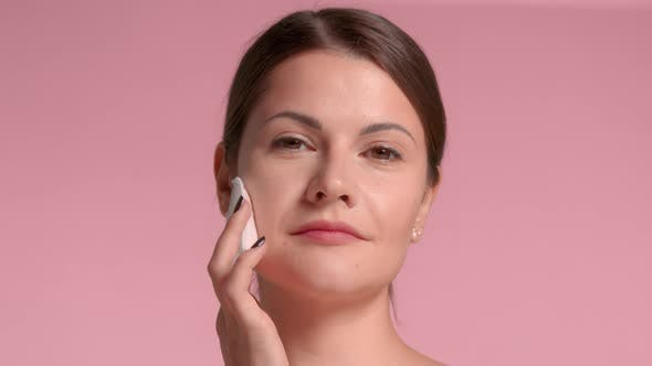 Thumbnail for Woman with Peeling Pads Facial Treatment