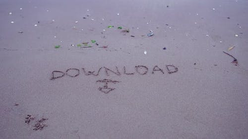 """Written """"Download"""" on the Sand"""
