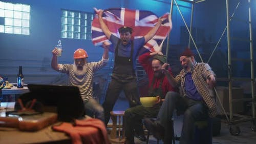 Excited Men Celebrating Great Britain Victory