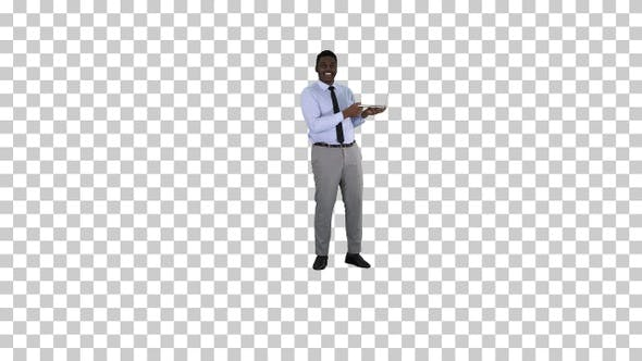 Thumbnail for Talking to camera young african man with laptop in his hands