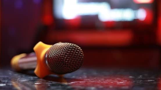 Thumbnail for Karaoke microphone in room