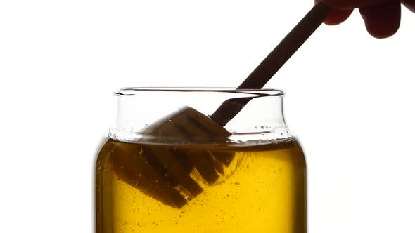 Thumbnail for Glass Jar of Honey with Wooden Spoon, Pick It Up, Isolated on White, Slow Motion, Slose Up