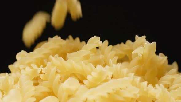 Thumbnail for Macro shot of falling of spiral (pasta) on a heap