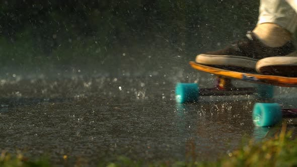 Thumbnail for Longboarding on the road in the rain, slow motion