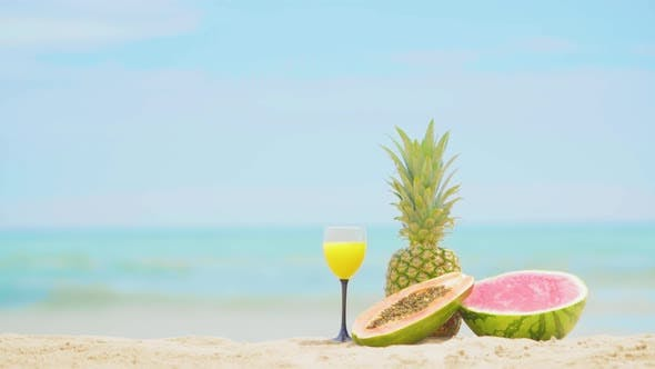 Thumbnail for Fruits on the Sea Background. Beautiful Fruit Cocktail Drink on Beach