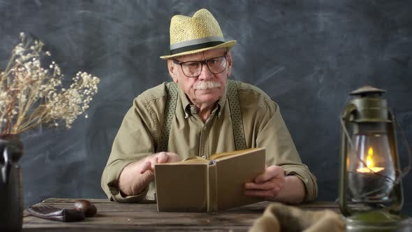 Thumbnail for Old-Fashioned Elderly Man Enjoying Book
