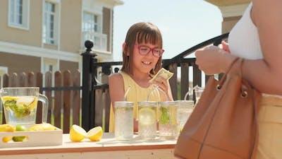 10-Year-Old Girl Selling Lemonade Outdoors