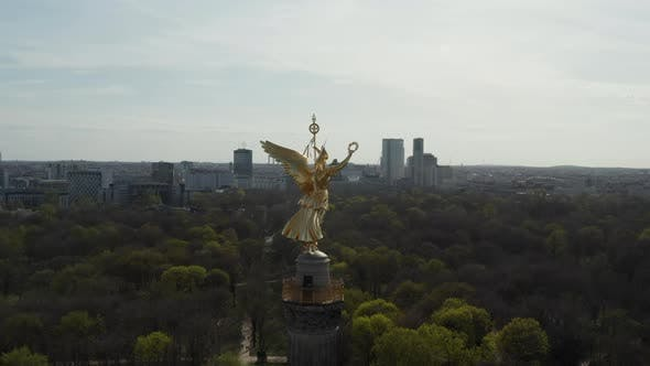 Thumbnail for Close Up Circling Around Berlin Victory Column Golden Statue Victoria in Beautiful Sunlight