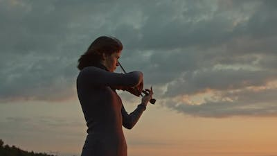 Woman Violinist Playing Solo Outside