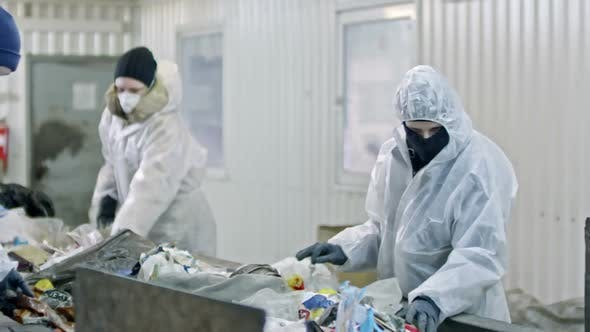 Thumbnail for Workers in Protective Suits Sorting Waste for Recycling