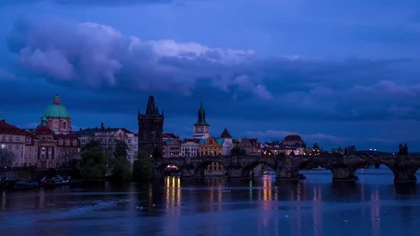 Thumbnail for Timelapse of the Charles Bridge and Vltava River From Dusk To Night in with Boats Prague, Czech