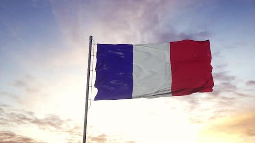 French National Flag Fluttering in the Wind Dramatic Sky Background