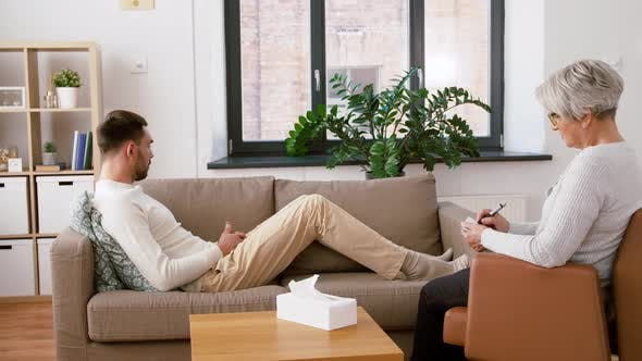 Cover Image for Man Patient Talking To Senior Woman Psychologist