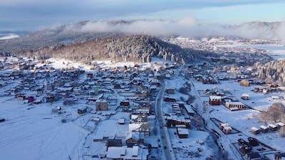 Snowy And Foggy Ski Resort At Sunset