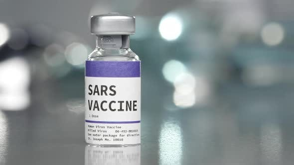 SARS vaccine vial in medical lab with syringe