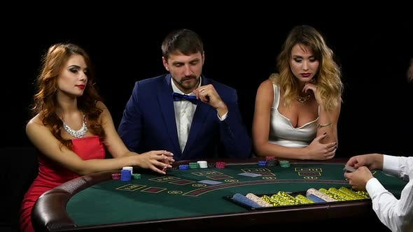Thumbnail for Croupier Deals the Card Three Players Sitting at the Table