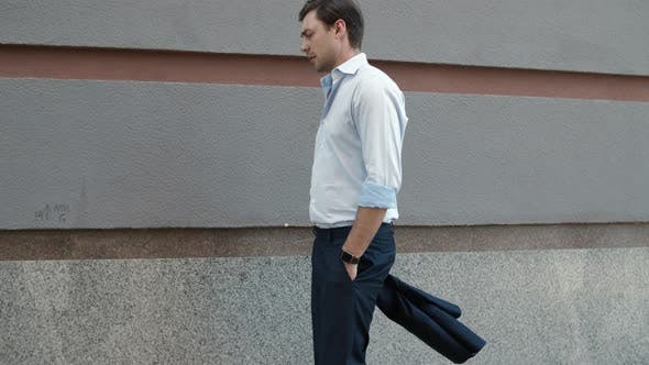 Thumbnail for Closeup Businessman Walking Near Building. Businessman Stretching Neck Outdoor