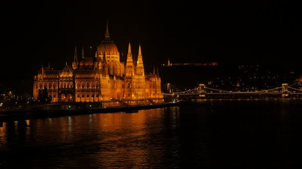 Thumbnail for Beautifully lighted national parliament of Hungary by the night on river Danube 4K 2160p 30fps Ultra