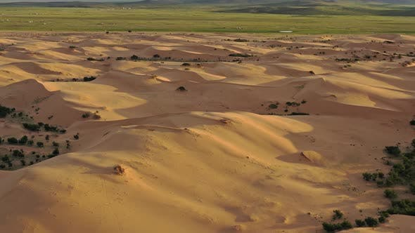Cover Image for Aerial Top View on Sand Dunes in Desert at Sunset