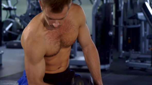 Thumbnail for Man Does Curls with Dumbbell