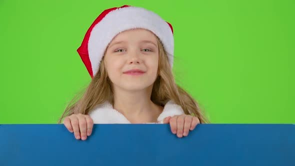 Thumbnail for Child Looks Out From Behind a Blue Board and Winks. Green Screen