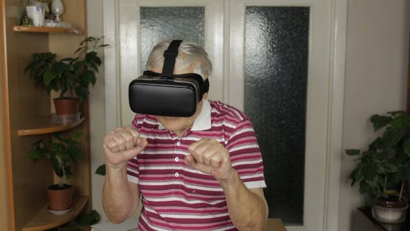 Thumbnail for Grandmother in Virtual Headset Glasses Watching Video in VR Helmet Training Box, Shows Fist Fight