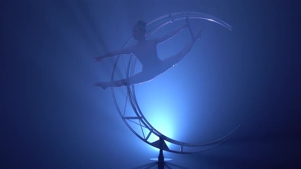 Thumbnail for Gymnast in a Brilliant Costume Performs Tricks on a Special Design