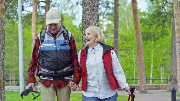 Thumbnail for Elderly Couple Walking in Park