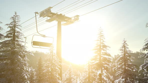 Thumbnail for Empty Ski Lift. Chairlift Silhouette on High Mountain Over the Forest at Sunset