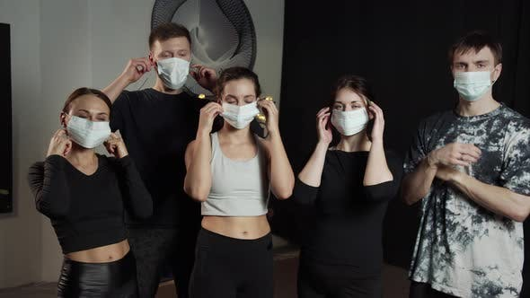 Group of Sporty People are Taking Off Face Masks and Throwing It Away