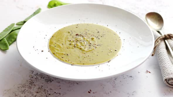 Thumbnail for Creamy Soup with Green Pea in a Ceramic White Plate