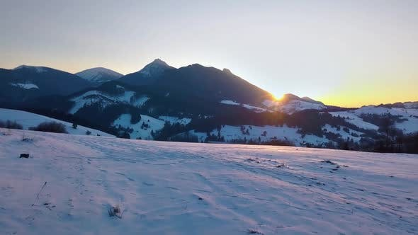 Cover Image for Colorful Sunset over Mountains in Winter Landscape