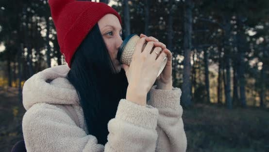 Thumbnail for Young Female Smiling And Drinking Coffee