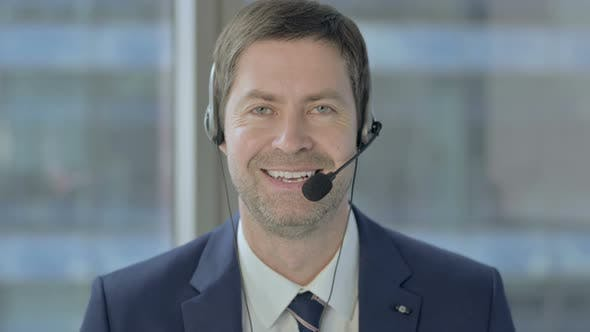 Thumbnail for Businessman with Headset Smiling and Looking at Camera