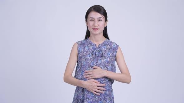 Thumbnail for Happy Pregnant Asian Woman Giving Handshake