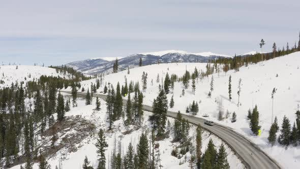 Thumbnail for Grey Truck Traveling Along Mountain Road Winter Snow Aerial Birds Eye Drone View