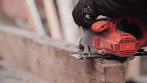 Thumbnail for Unidentified Worker in Work Gloves Cutting Piece of Thick Board with Grinder, Closeup in Slow Motion