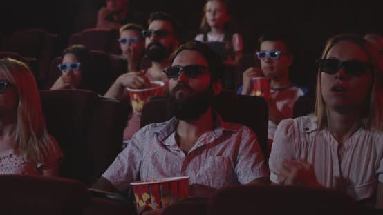Thumbnail for Captivated Audience Watching Movie in Cinema