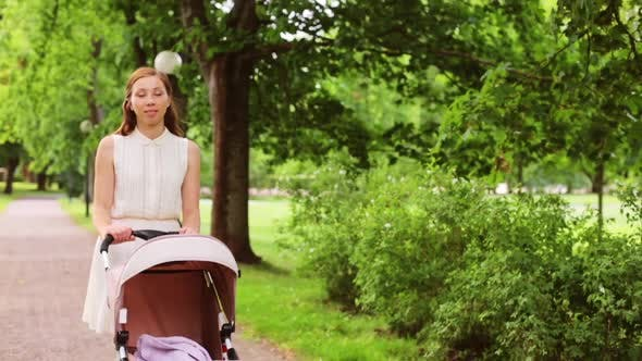 Thumbnail for Happy Mother with Baby in Stroller at Summer Park